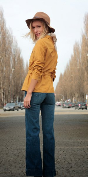 Mustard yellow suede shirt with belt and blue flared jeans