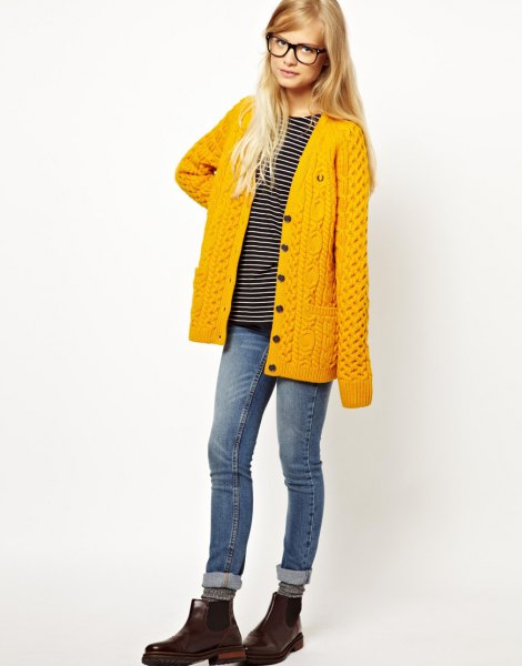 mustard-yellow cardigan with cuffed jeans and leather boots
