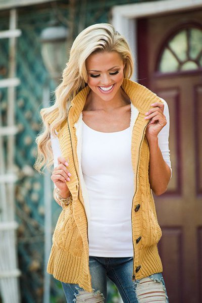Mustard yellow knitted vest with hood and white top