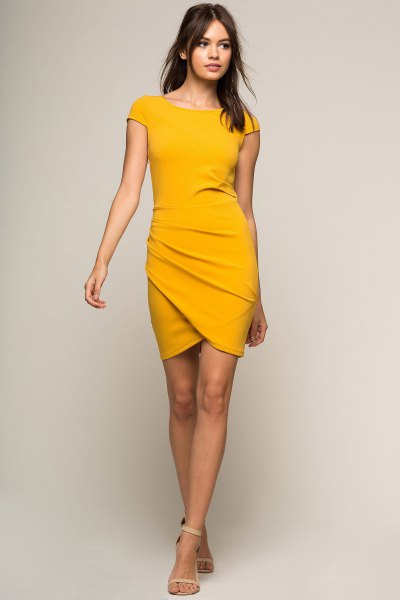 Bodycon wrap dress with mustard yellow sleeves