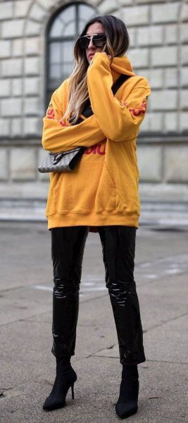 Mustard yellow chunky hoodie with black slim fit jeans