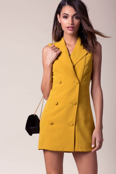 Mustard yellow double-breasted mini dress with black heels
