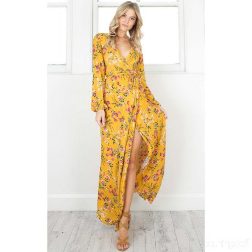 Mustard yellow, high split, long wrap dress with a floral pattern