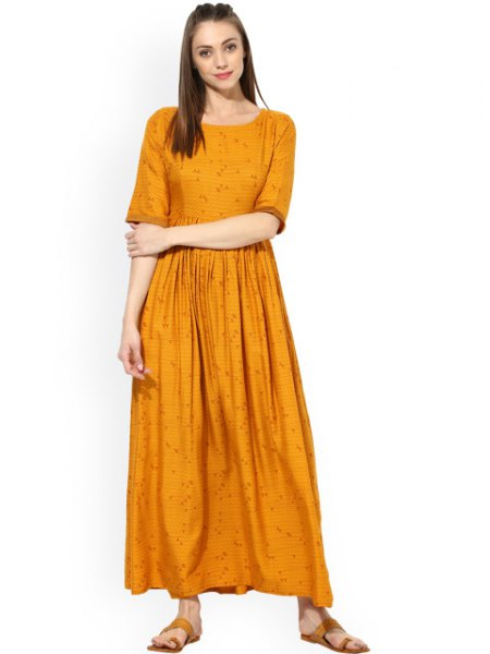 Mustard yellow, half-sleeved, pleated maxi dress with a relaxed fit