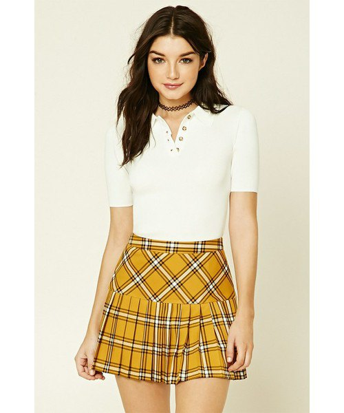 Mustard yellow checked pleated mini skirt with white polo shirt