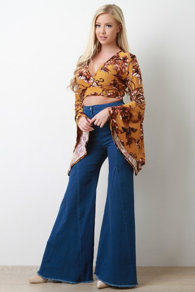 Mustard yellow printed, short cut blouse with bell sleeves and flared jeans