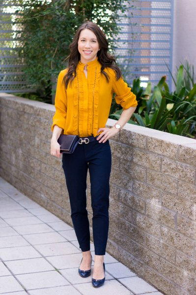 Mustard-yellow frilled mid-blouse with black chinos