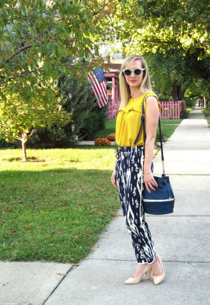 Mustard yellow sleeveless top with black and white printed pants with a relaxed fit