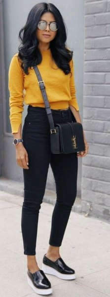 Mustard yellow, slightly cropped sweater with black ankle jeans