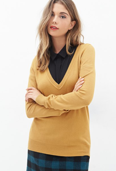 Mustard yellow V-neck sweater and black shirt with buttons