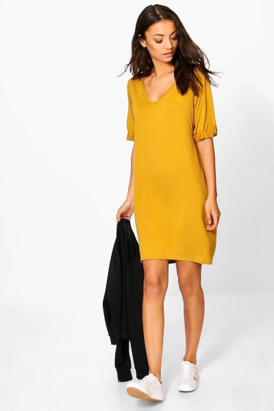 Mustard yellow V-neck t-shirt dress and white sneakers