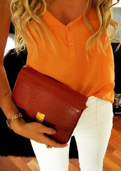 Mustard yellow vest top with white skinny jeans and burgundy leather clutch