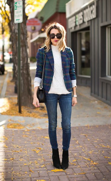 dark blue and green plaid jacket, white turtleneck with turtleneck