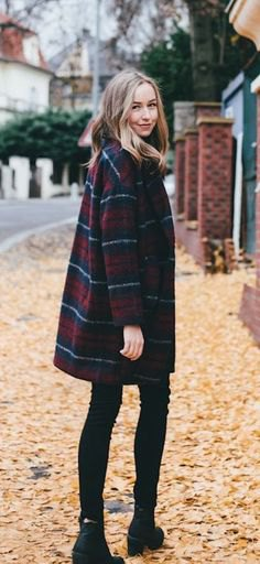 Dark blue and red checked coat with black skinny jeans and boots