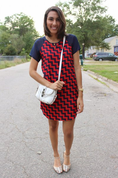 Mini dress with dark blue and red zigzag print and silver strappy sandals