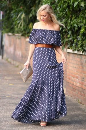 Dark blue and white polka dots on the maxi dress with shoulder girdle