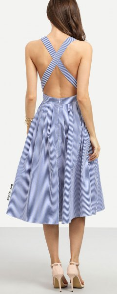 Dark blue and white striped midi dress with a crossed back