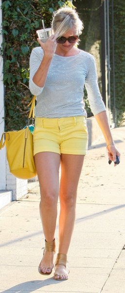 dark blue and white striped three-quarter T-shirt with yellow shorts