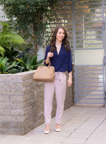 Navy blouse with pink tie pants with a loose fit in the front