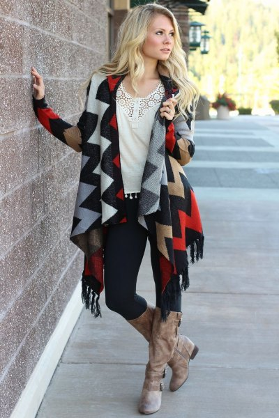 dark blue and orange cardigan with zigzag print and long boots