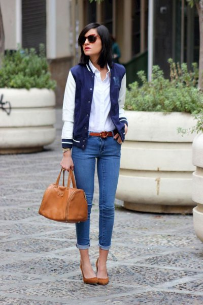 Dark blue and white bomber baseball jacket with a white buttoned shirt