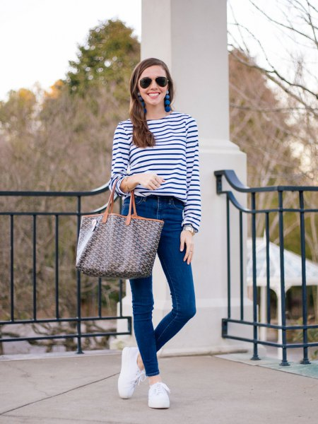 dark blue and white striped long-sleeved T-shirt with skinny jeans