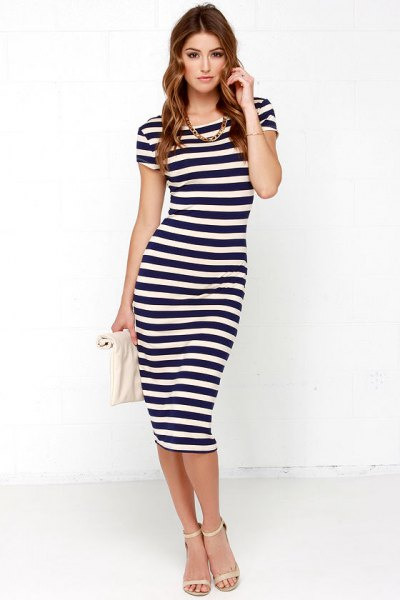 Dark blue and white striped, figure-hugging midi dress with pink heels with open toes