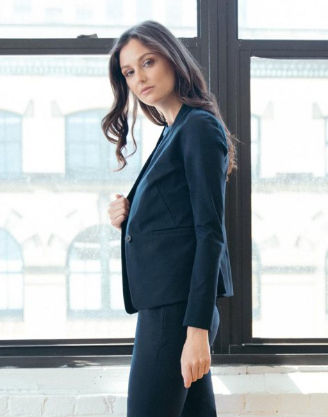 Dark blue blazer jacket with white blouse and slim pants