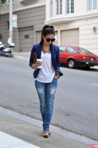 Dark blue blazer jacket with white t-shirt and ripped jeans