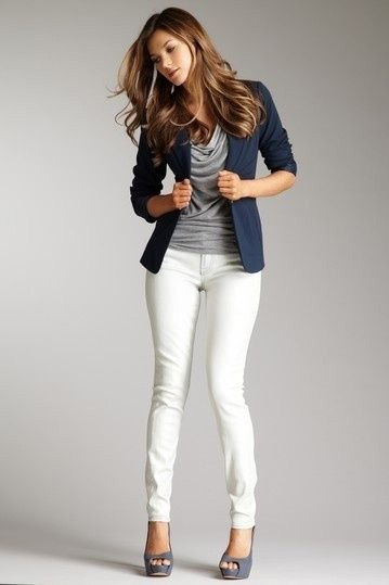 Dark blue blazer with a gray top with a waterfall neckline and white skinny jeans