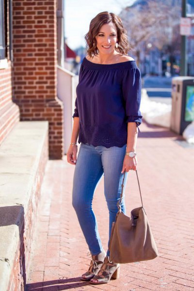 Dark blue top with a boat neckline and light pink sandals