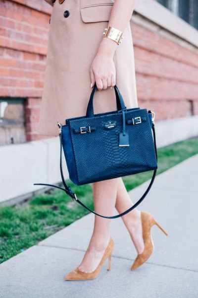 Dark blue briefcase with light pink longline trench coat