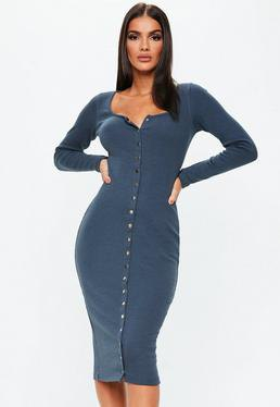 dark blue, figure-hugging long-sleeved dress with buttons