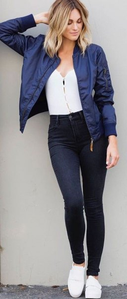 Dark blue, short cut bomber jacket with a white top