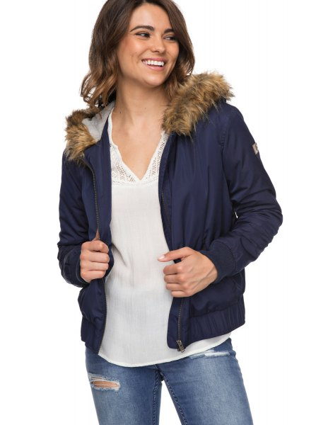 Dark blue bomber jacket with hood made of faux fur and chiffon blouse