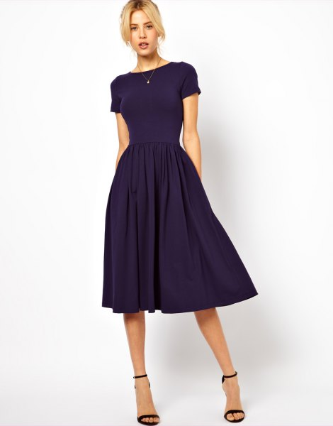 Dark blue, short-sleeved midi dress with a fit and flare with matching open toe heels