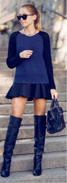 Dark blue, fitted sweater with black mini pleated skirt and overknee boots