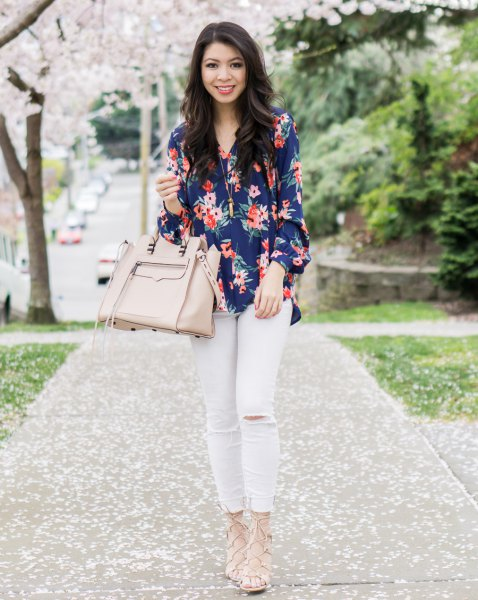 Dark blue shirt with floral pattern and white jeans