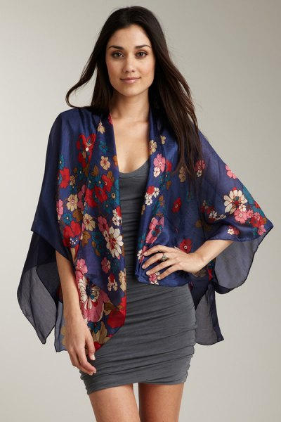 Dark blue chiffon cardigan with floral pattern and gray, figure-hugging dress with a scoop neckline