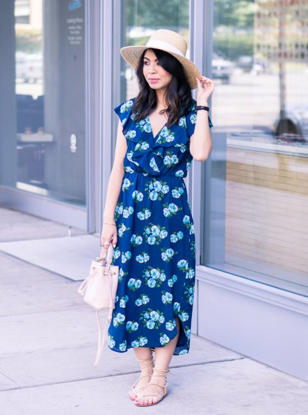 Dark blue midi dress with a V-neckline and floral pattern and strappy sandals