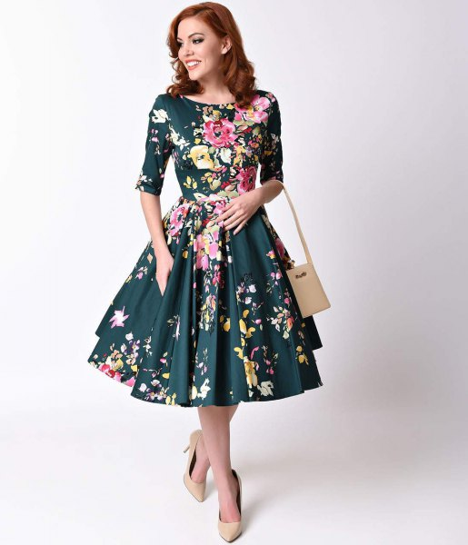 Dark blue dress with half sleeves and a flared midi dress with a Hawaiian print