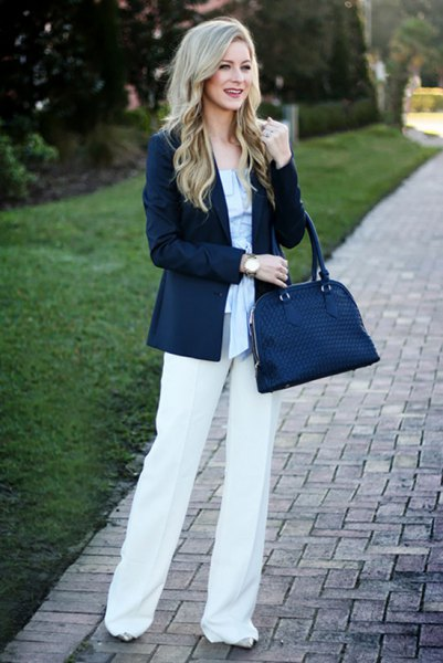 Navy blue handbag with a sky blue blouse and blazer