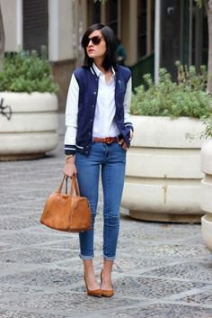Dark blue jacket with white shirt with buttons and slim fit jeans with cuffs