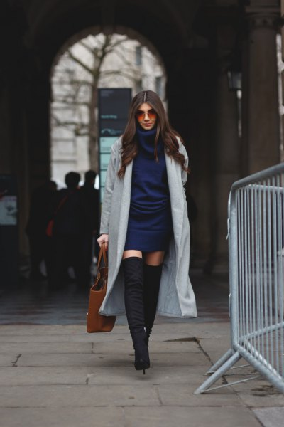 Dark blue knitted dress with a gray maxi blazer and overknee boots