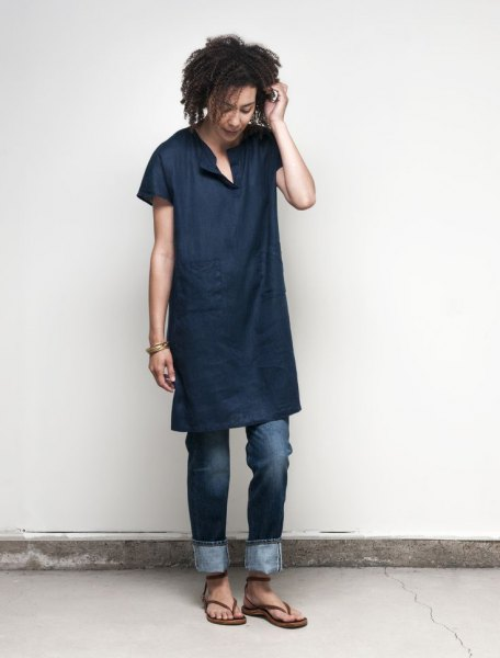 Dark blue linen tunic shirt with dark jeans with cuffs