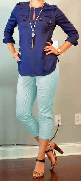 Dark blue long-sleeved keyhole blouse with white, shortened trousers