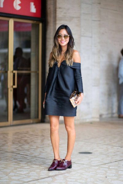 Dark blue, long-sleeved mini dress with black buck shoes
