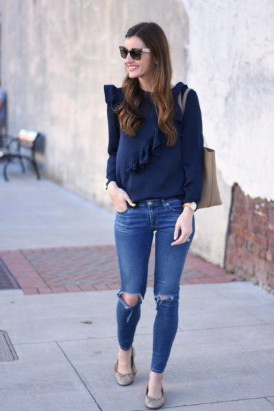 Dark blue long-sleeved top with blue ribbed skinny jeans