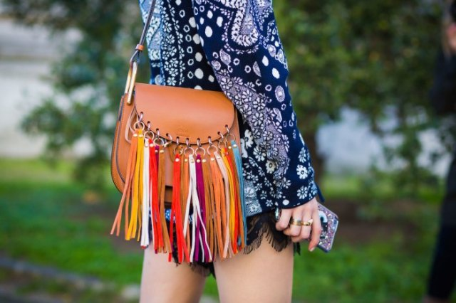 Dark blue, long-sleeved tribal mini dress with tribal print and brown leather wallet with fringes