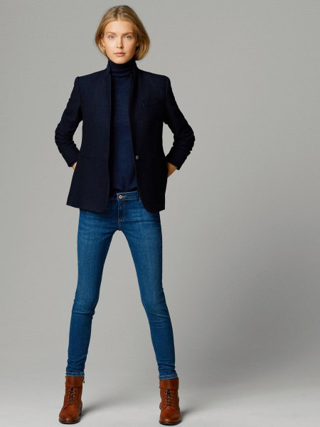 Dark blue sweater with a stand-up collar and matching jacket and skinny jeans